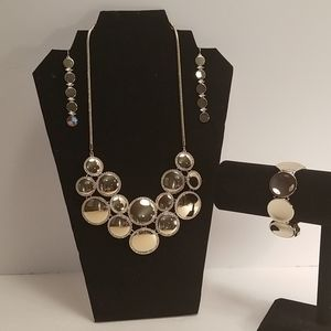 Gold tone circles with crystals 3 piece set